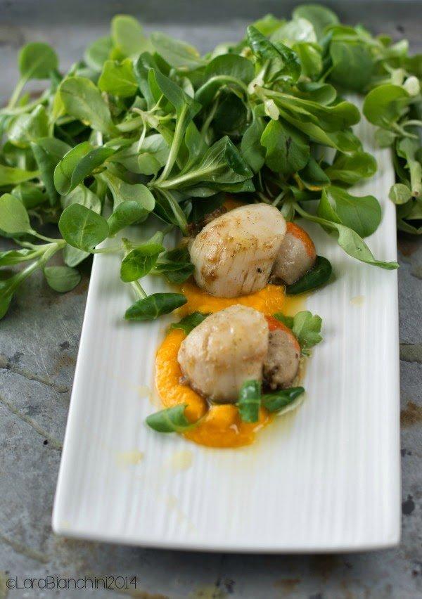 Crema di carote alle Capesante con insalata di soncino