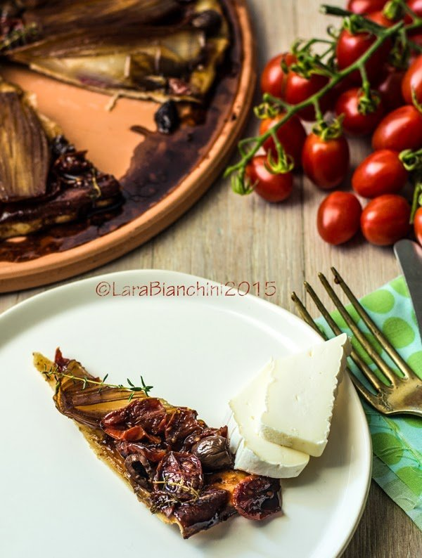 tarte tatin with confit tomatoes and red onions