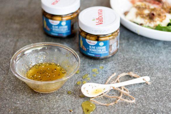 quartirolo in crosta di semi con olive e crudo
